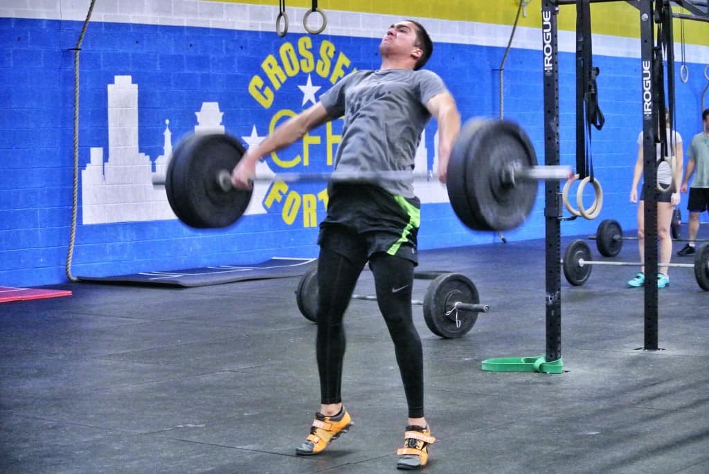 Troy demonstrating the triple extension (hips, knees, ankles) in the snatch